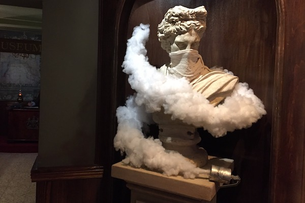 Greek statue choking on teargas in the lobby of The Walled Off Hotel, Bethlehem, March 3, 2017. (Haggai Matar)