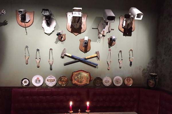 A wall featuring security cameras, slingshots, and other Banksy motifs, The Walled Off Hotel, Bethlehem, March 3, 2017. (Haggai Matar)