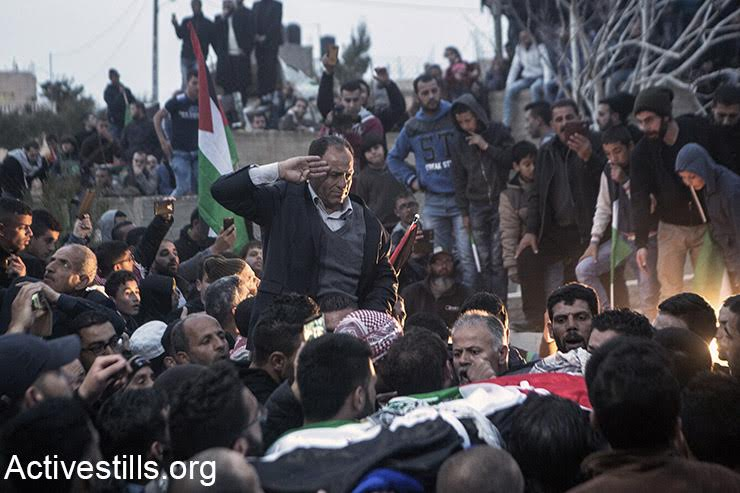The father of Basel al-Araj says a last goodbye to his son as he is buried, Al Walaja, West Bank, March 16, 2017. (Activestills.org)