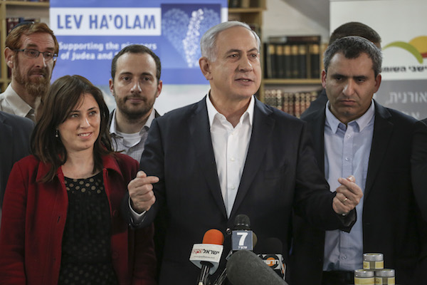 Prime Minister Benjamin Netanyahu, is joined by Likud members Yehuda Glick, Tzipi Hotovely and Ze'ev Elkin on a tour of the 'Lev HaOlam' (Heart of the World) organization, Jerusalem, February 3, 2015. The organization promotes the export and sale of products from Jewish settlements in the West Bank, and aims to fight the boycott of Israeli settlement products. (Hadas Parush/Flash90)