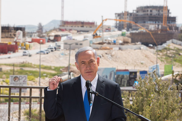 Israeli Prime Minister Benjamin Netanyahu gives a statement to the press in front of construction in the Har Homa settlement in Jerusalem, March 16, 2015. (Yonatan Sindel/Flash90)