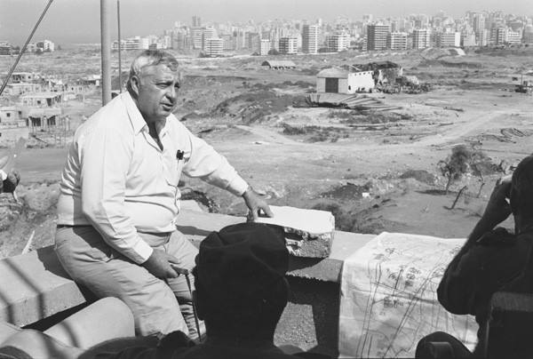 Then-Israeli Defense Minister Ariel Sharon at an IDF command post with Beirut in the background, Lebanon, September 15, 1982. The Sabra and Shatila massacre started the day after this photo was taken. (Uri Dan, The Israeli Defense Forces Archive/CC 2.0)