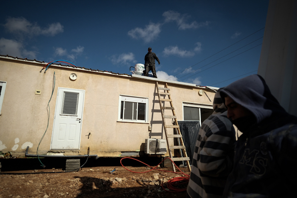 Illustrative photo of construction workers preparing new caravan homes in the Israeli settlement of Ofra. (Yaniv Nadav/Flash90)