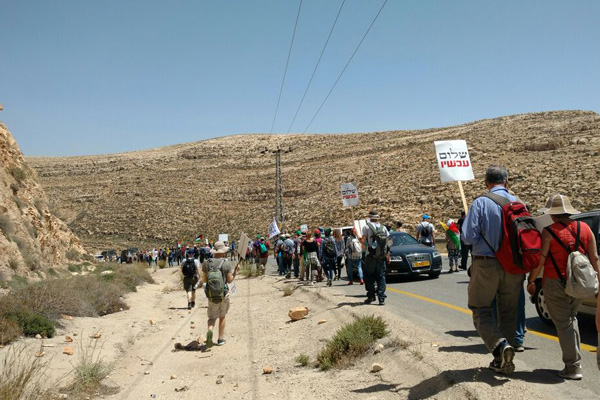 Israeli anti-occupation activists march toward a settlement in the Jordan Valley area of the West Bank to protest settler violence, April 28, 2017. (Orly Noy)