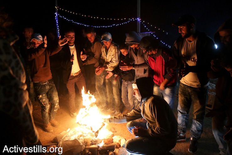 Palestinians and activists dance dabka, just a few hours before Israeli soldiers raided Sumud Freedom Camp for the first time, Sarura, West Bank, May 20, 2017. (Ahmad al-Bazz/Activestills.org)