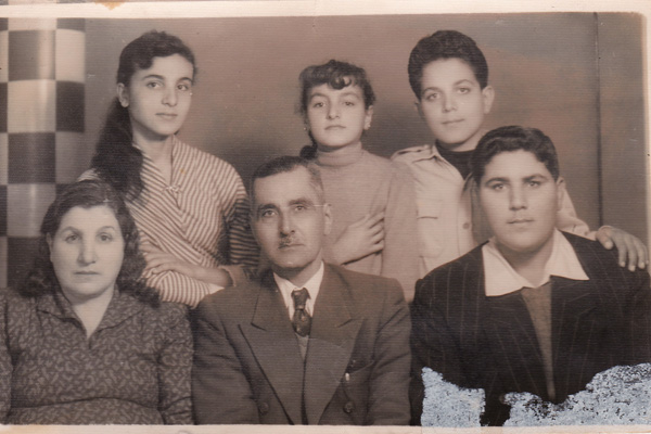 My father, standing in the back row, with his parents and three of his siblings in Tulkarem.