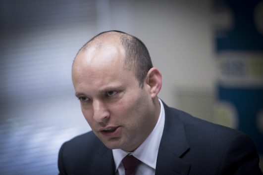 Jewish Home head Naftali Bennett leads a party faction meeting at the Knesset, December 12, 2016. Bennett rejects the Palestinian of a Palestinian state under any framework, yet the U.S. has not boycotted him. (Yonatan Sindel/Flash90)