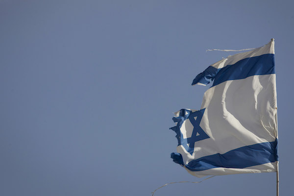 A torn Israeli flag seen at the settlement of Gevaot, September 2, 2014. (Miriam Alster/FLASH90)