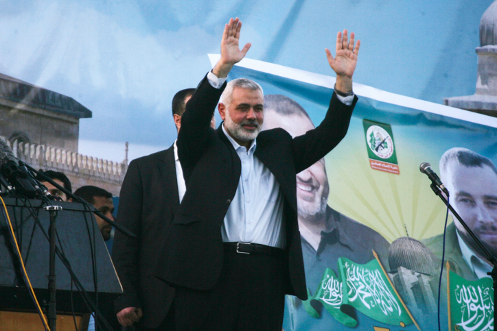 Hamas head Ismail Haniyeh waves to the crowd during a rally, February 26, 2016, in the southern Gaza Strip city of Rafah. (Abed Rahim Khatib/ Flash90)