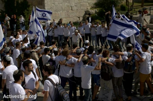 "Israelis take part in the ""March of the Flags,"" an annual event on Jerusalem Day held to mark what the Israeli Right sees as the 'unification' of the city, May 24, 2017. (JC/Activestills.org)"