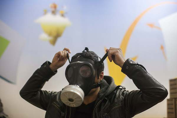 Israeli postal workers distribute gas masks to residents of Jerusalem amid warnings of chemical weapons used by both sides in the Syrian civil war, January 30, 2013. (Yonatan Sindel/Flash90)