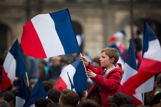 Supporters of French president-elect Emmanuel Macron celebrate outside the Louvre in Paris, May 7, 2017. (Yonatan Sindel/Flash90)