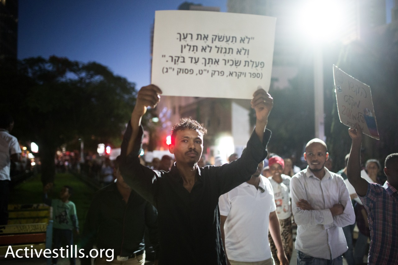 An African refugee marches during a protest against a new law to deduct wages from refugees, Tel Aviv, June 10, 2017. (Yotam Ronen/Activestills.org)