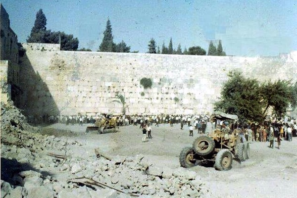 Israeli bulldozers clear what remained of the Mughrabi Quarter, which was destroyed by the Israeli army following the capture of Jerusalem's Old City. (Olevy/CC BY-SA 3.0)