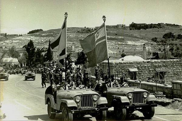 Two IDF jeeps drive in a parade through Jerusalem, 1968. (A. Eisenberg/Lehava Kiryat Mozkin, CC 2.5)