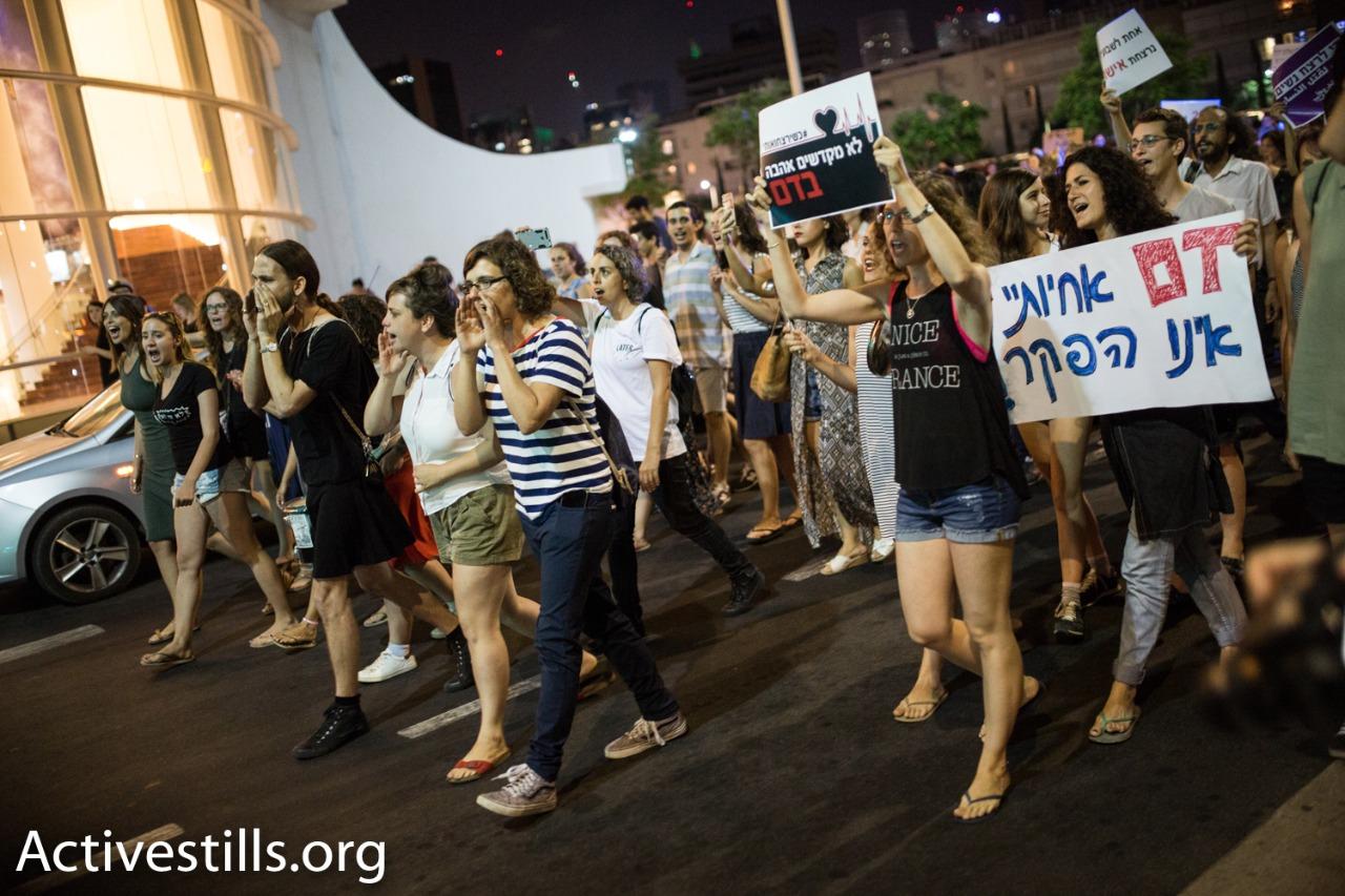 Dozens of women march through central Tel Aviv to protest violence against women, central Tel Aviv, July 17, 2017. (Yotam Ronen/Activestills.org)