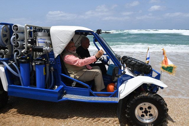 "Prime Ministers Netanyahu and Modi take a spin on the mobile desalination unit. (Kobi Gideon/GPO) ""But Israel's desalination plants are firmly dug into the Mediterranean coast, not attached to four-wheel drive vehicles. And when Gaza has no power, we all swim in refuse."""