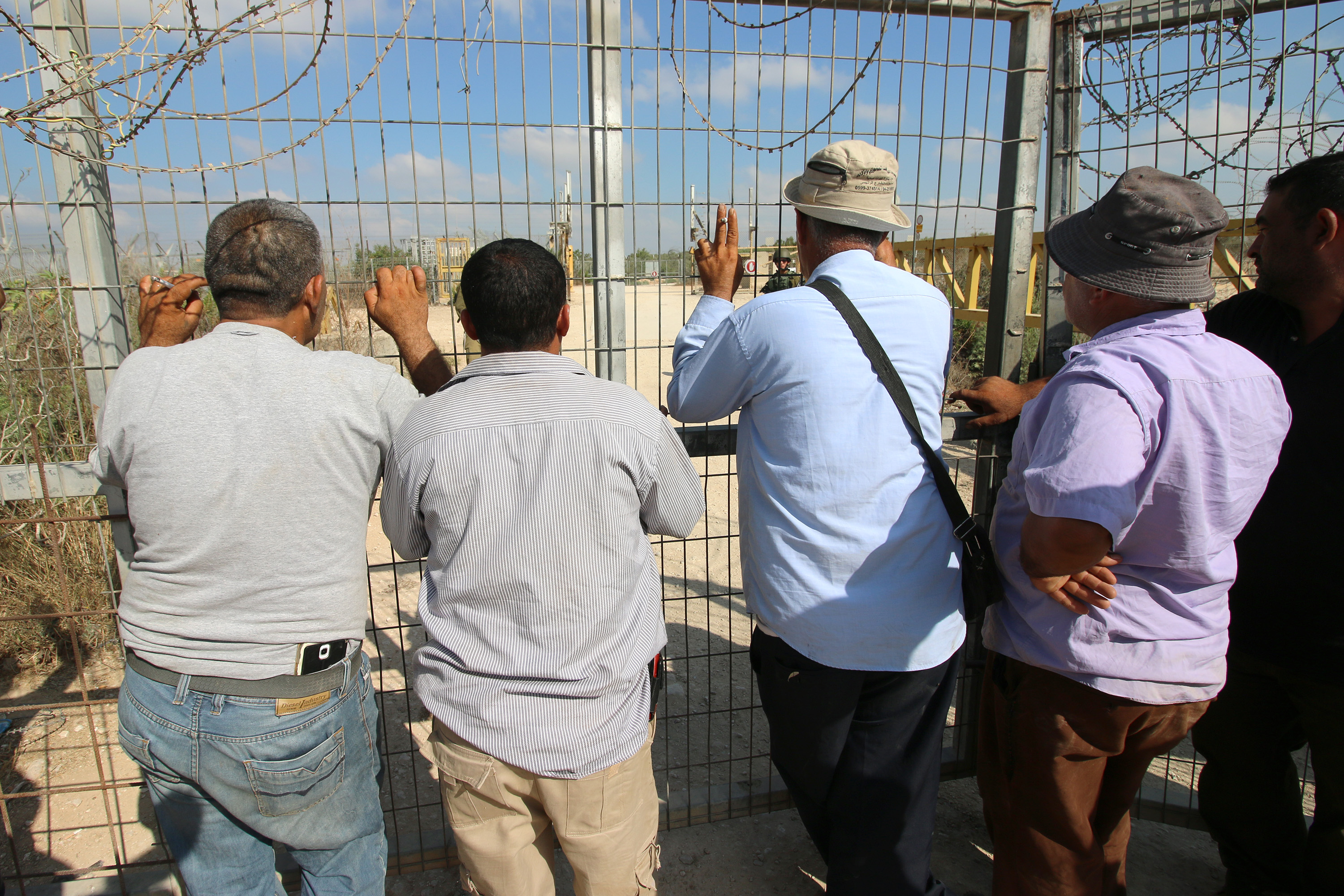 Palestinian farmers protest at a military gate in the northern West Bank, demanding the Israeli army ease restrictions to allow them to more easily enter and exit, Deir Al Ghusun, July 9, 2017. (Ahmad al-Bazz/Activestills.org)