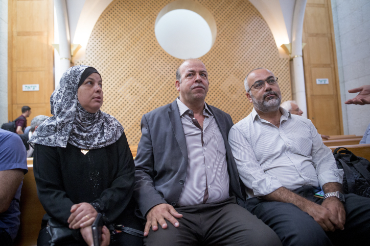 The parents of Mohammed Abu Khdeir seen with MK Saadia Osama (R) in Israel's Supreme Court in Jerusalem, September 22, 2016. (Yonatan Sindel/Flash90)
