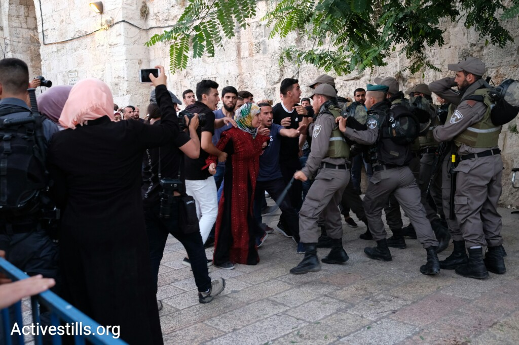 Clashes erupt between Palestinian demonstrators and Israeli security forces after authorities sealed off the entrance to the Temple Mount/Haram al-Sharif following a deadly attack on Israeli police officers last week, Jerusalem, July 16. (photo: Activestills.org)