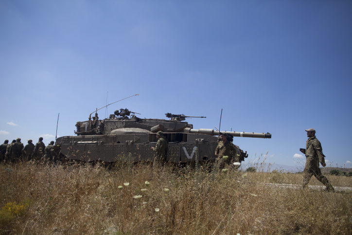 Israeli soldiers seen during patrol in the Golan Heights after a 15-year-old Israeli boy was killed on June 22, 2014, in what the IDF said was a missile attack from Syria, just south of the Quneitra crossing. (Flash90)