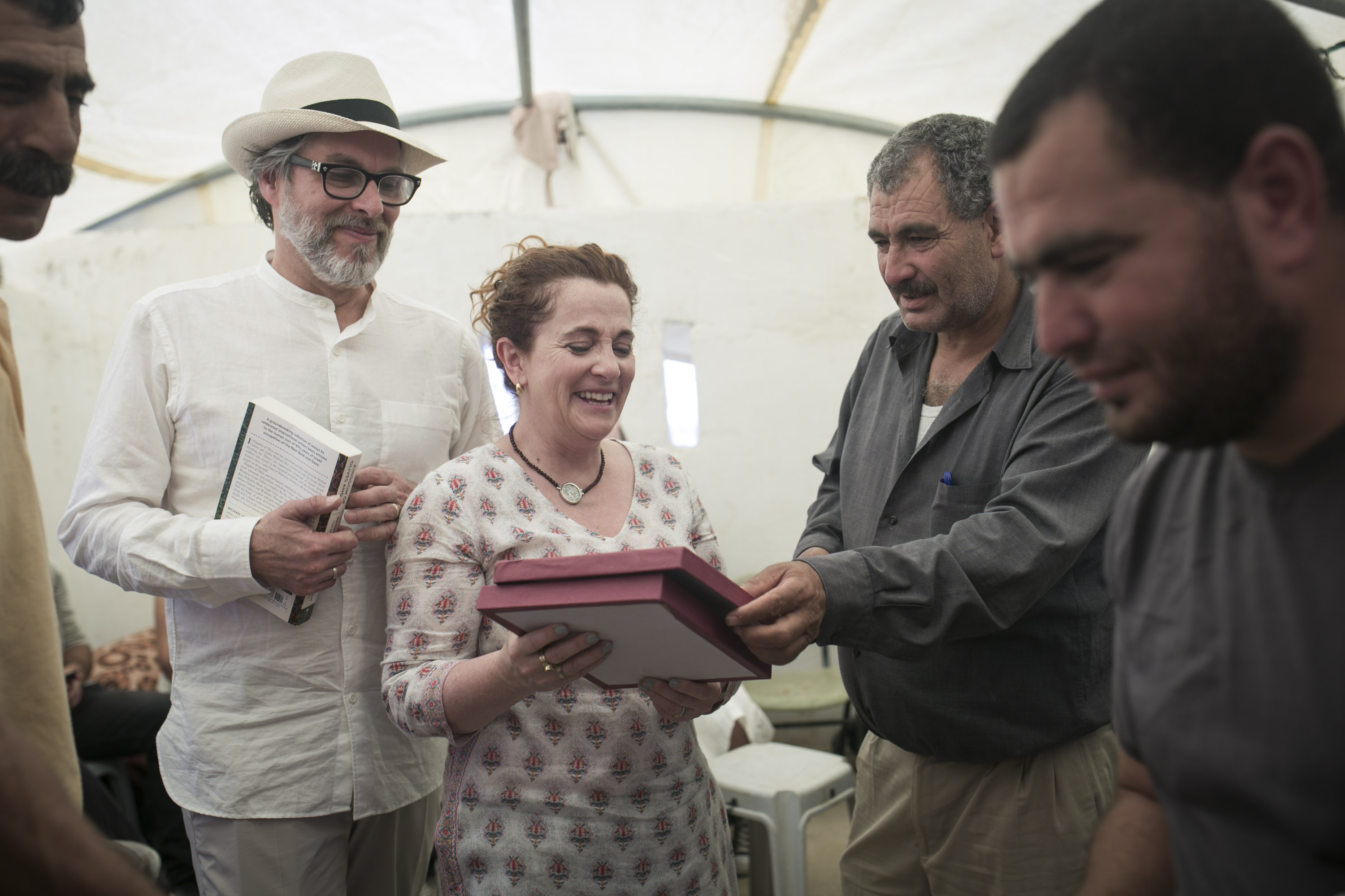 Authors Michael Chabon (left) and Ayelet Waldman (middle left) receive a plaque from the Palestinian residents of Susya, recognizing their contribution to the village's struggle. (Breaking the Silence)