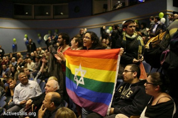 LGBTQ and housing rights activists interrupt a Jewish Home election event at Tel Aviv University to protest the party's homophobia. (Activestills.org)