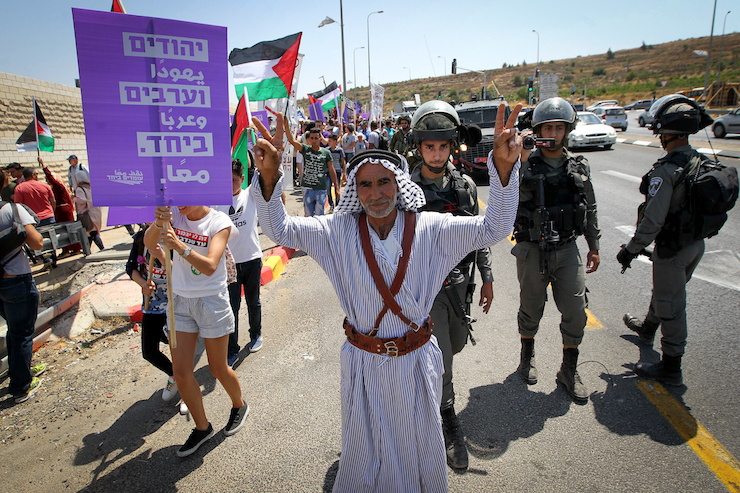 Fadel Aamer, a Palestinian man who along with hundreds of Jewish American, Israeli and Palestinian activists recently reclaimed his land in Sarura, from which he was expelled 20 years ago, participates in the pro-peace march, July 7, 2017. (Wisam Hashlamoun/Flash90)