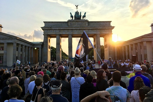 Berliners hold a candlelight vigil following the murder of Heather Heyer by a white supremacist in Charlottesville, Virginia. (Michael Mayer/CC-BY-2.0)