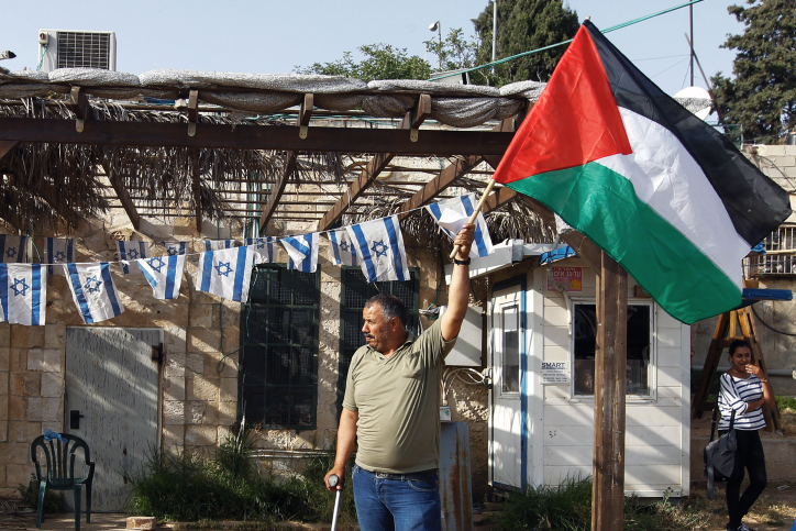 A Palestinian man is seen during a weekly demonstration against Jewish settlements and impending evictions of Palestinian families from their homes in the East Jerusalem neighborhood of Sheikh Jarrah, May 17, 2013. (Flash90)