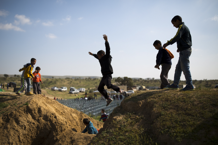 Bedouin kids play near a protest marking the 40th anniversary of Land Day, in Umm Al-Hiran, southern Israel, March 30, 2016. (Corinna Kern/Flash90)