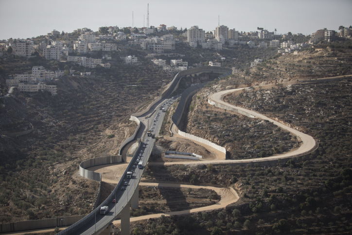 View of the separation wall and the West Bank village of Beit Jala as it seen from Gilo, Jerusalem, December 4, 2016. (Nati Shohat/Flash90)