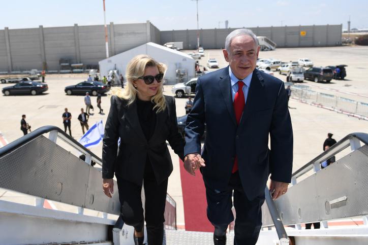 Prime Minister Benjamin Netanyahu and his wife Sara depart to visit Stassburg, France, from Ben Gurion Airport, near Tel Aviv, on June 30, 2017. (Kobi Gideon/GPO)