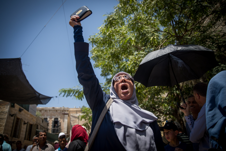 Muslim women protest in front of the Lion's Gate entrance to the Temple Mount, in Jerusalem's Old City, after metal detectors were placed ahead of its opening, July 16, 2017. (Yonatan Sindel/Flash90)