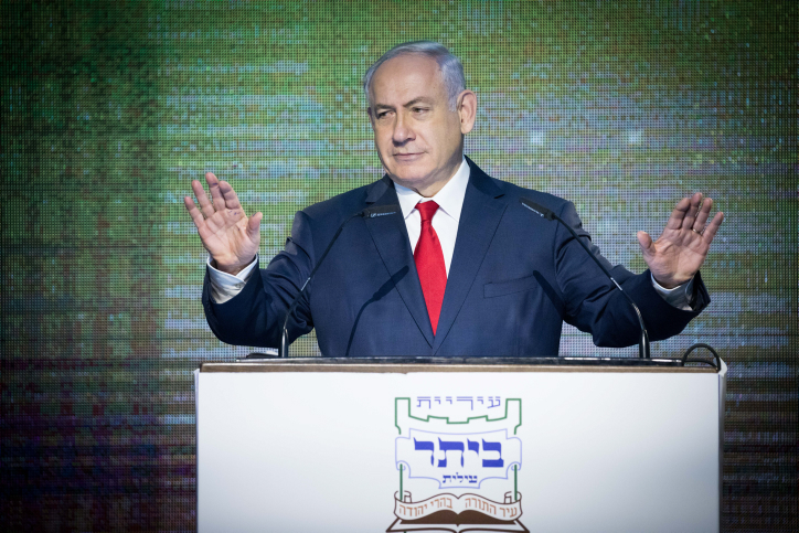 Israeli Prime Minister Benjamin Netanyahu speaks during a cornerstone laying ceremony for a new neighborhood in Beitar Illit, West Bank, August 3, 2017. (Nati Shohat/Flash90)