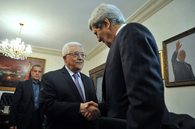 "John Kerry has a private chat with Mahmoud Abbas in Ramallah, December 12, 2013. ""Kerry believed his personality and determination could lead to an agreement within nine months. Thrall calls it 'faith-based diplomacy'."" (State Dept photo)"