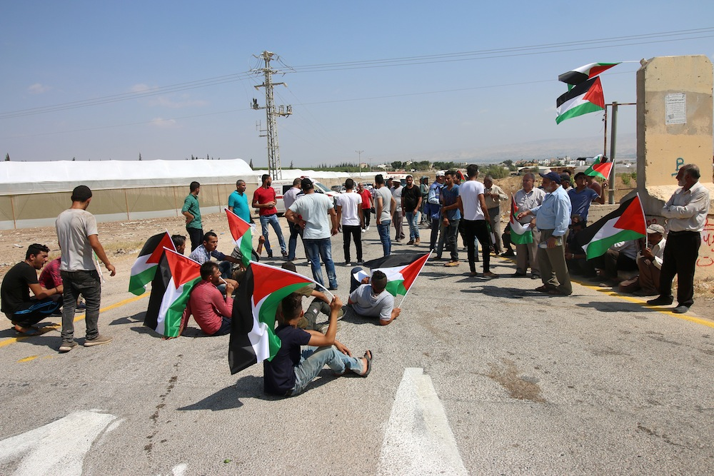 Palestinians from the northern West Bank village of Ein al-Beida staged a protest last week against an Israeli decision to cut off the water supply to their village for over a week. (Ahmad Al Bazz/Activestills.org)