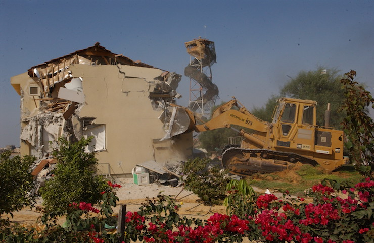 The Israeli army demolishes the Ganey Tal settlement in Gush Katif, Gaza, during the disengagement. August 22, 2005. 'The Second Intifada broke the taboo on withdrawing from settlements anywhere in the greater Land of Israel, ultimately leading to Sharon's Disengagement Plan.' (Yossi Zamir/Flash90)