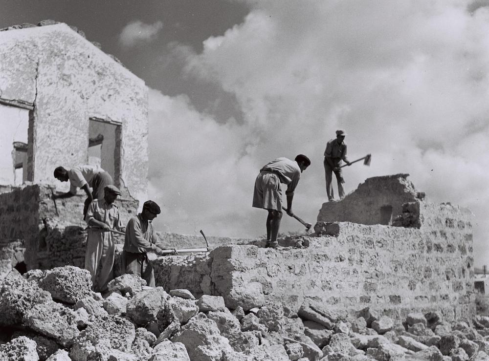 Jewish workers demolish homes in Jaffa following the 1948 battle that cleared the city almost all its Palestinian residents, October 6, 1949. (Fritz Cohen/GPO)