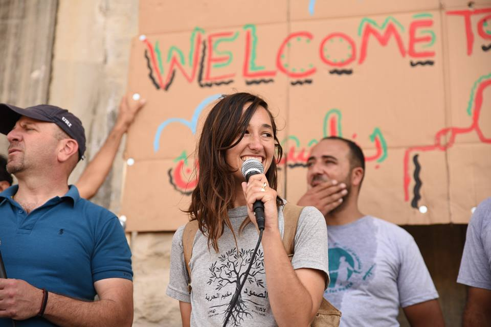 Achvat Amim leader Karen Isaacs speaks at a Combatants for Peace event in Beit Jala, West Bank. (Rami Ben-Ari)