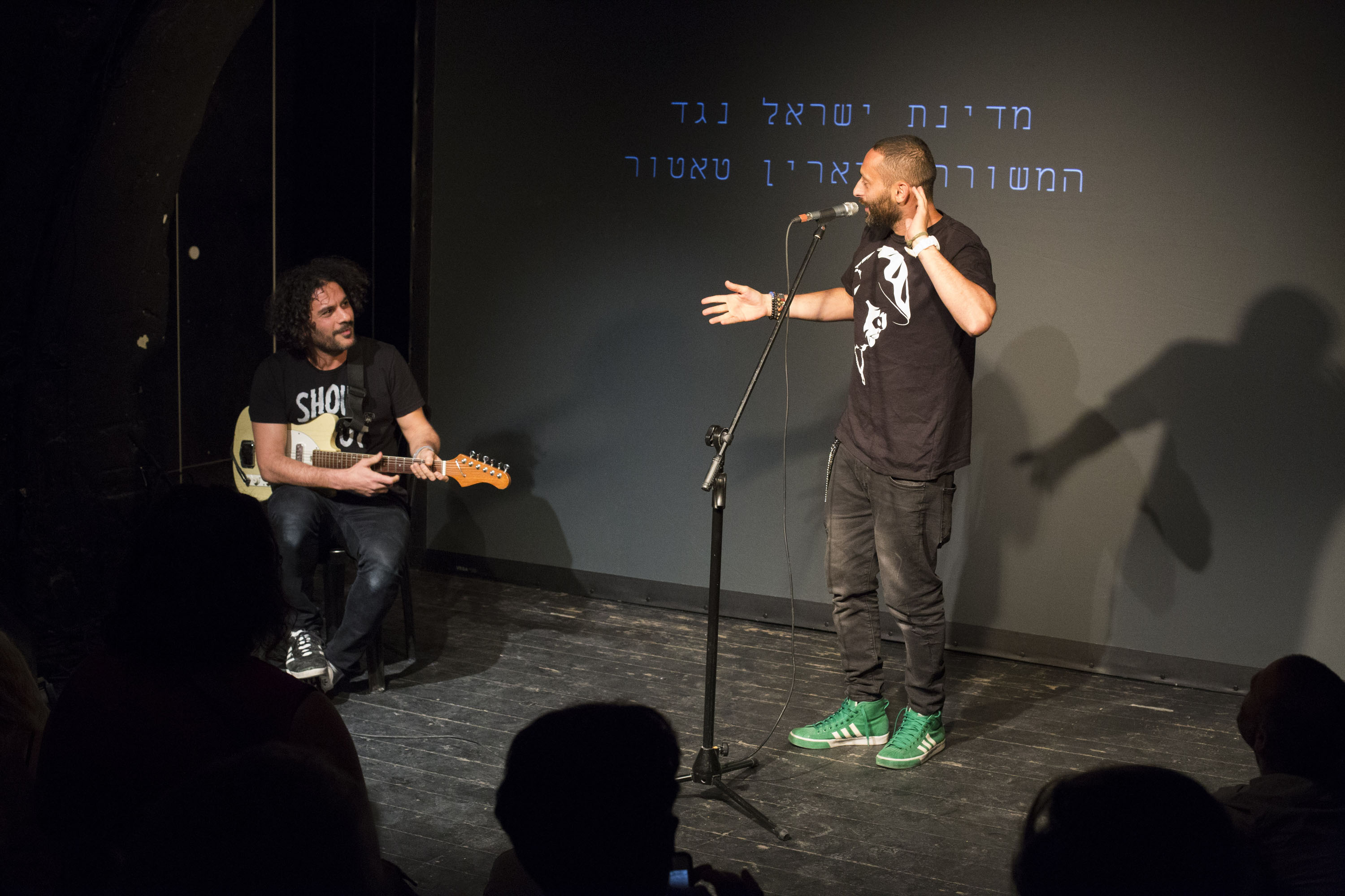 Palestinian hip hop artist Tamer Nafar and Israeli musician Itamar Ziegler perform during a solidarity event for Palestinian poet Dareen Tatour, Jaffa, August 31, 2017. (Keren Manor/Activestills.org)