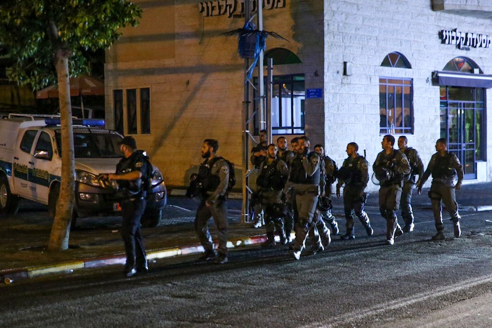 Israeli riot police are seen patrolling in Jaffa a day after an officer shot Mahdi Sa'adi to death in the city, July 29, 2017. (Flash90)