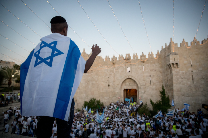 Thousands of Israeli Jews wave flags as they mark Jerusalem Day in Damascus Gate on their way to the Western Wall, East Jerusalem, May 24, 2017. (Yonatan Sindel/Flash90)