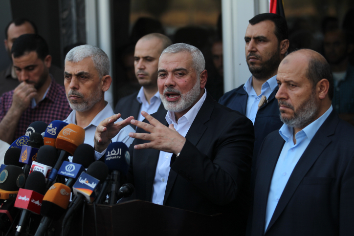 Hamas Chief Ismail Haniyeh speaks to the press upon his arrival at the Rafah border crossing from the Egyptian side following reconciliation talks with Fatah mediated by Egyptian intelligence, Gaza Strip, September 19, 2017. (Abed Rahim Khatib/ Flash90)