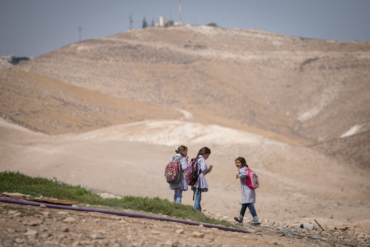 Bedouin students seen in their village outside of the Israeli settlement of Kfar Adumim. September 25, 2017. (Miriam Alster/Flash90)