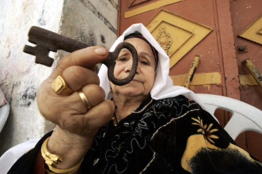 Illustrative photo of a Palestinian refugee, Laila Abdel Meguid Tafesh, 78, holding a key she says is from her house in Jaffa. (Abed Rahim Khatib / Flash90)