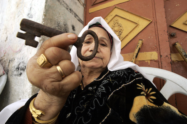 Palestinian refugee Laila Abdel Meguid Tafesh 78 years old, from the Rafah refugee camp, holds up a key she says is from her house in Jaffa. (Abed Rahim Khatib / Flash90)