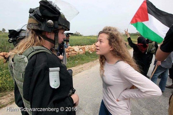Ahed Tamimi faces down a soldier in Nabi Saleh. (Haim Shwarczenberg)