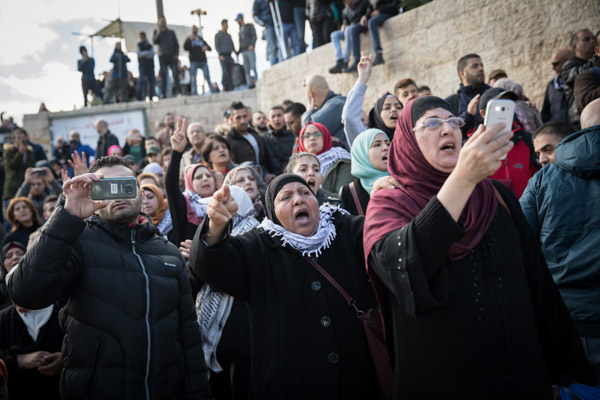 Palestinians in East Jerusalem protest President Donald Trump's announcement about recognizing Jerusalem as the capital of Israel, Damascus Gate, Jerusalem, December 7, 2017. (Hadas Parush/Flash90)