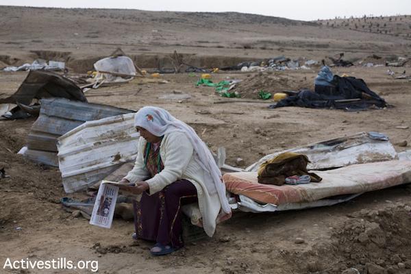 A Bedouin woman after authorities demolished her village of Al Araqib, January 16, 2011 (Keren Manor/Activestills.org)